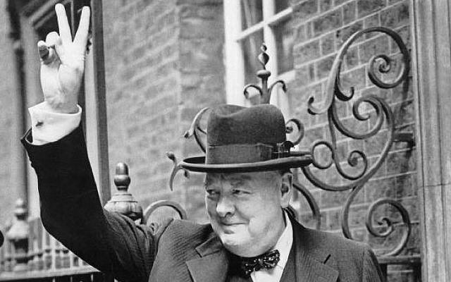 Winston Churchill in Downing Street giving his famous 'V' sign, 1943. (photo credit: Imperial War Museums/public domain)