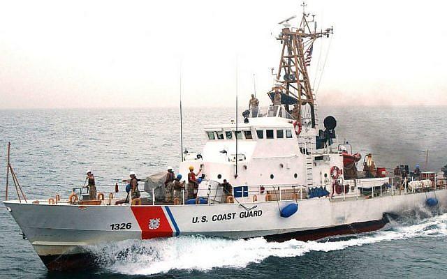 Coast Guardsmen aboard U.S Coast Guard Cutter Monomoy, Persian Gulf, April 27, 2005 (photo credit: US Navy photo by Journalist Seaman Joseph Ebalo)