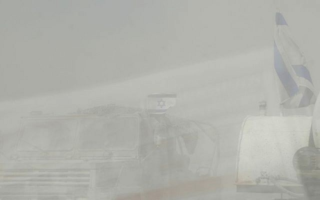 Dust kicked up by moving military vehicles made it tough to drive in southern Israel near the Gaza border on Tuesday.  (photo credit: Melanie Lidman/Times of Israel)