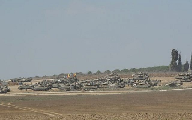 Israeli tanks waiting next to the border with Gaza on Tuesday afternoon near the Eshkol Region as the 72-hour ceasefire began. photo credit: (Melanie Lidman/Times of Israel)