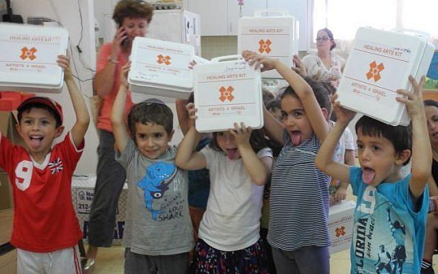 Kids at Kibbutz Alumim with the emergency art kits distributed by Artists 4 Israel. (Melanie Lidman/Times of Israel)