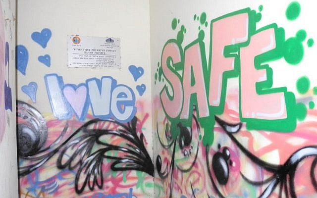 """New York Graffiti artist """"Broker"""" transformed the painted walls inside and outside of the bomb shelter into a cohesive mural, though his message could be interpreted a number of different ways. (Melanie Lidman/Times of Israel)"""
