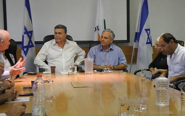 Environmental Protection Minister Amir Peretz and the CEOs of the largest Israeli supermarkets at a meeting on Wednesday to discuss an upcoming law that will require customers to pay 40 agorot for every plastic bag they use with their purchases. (photo credit: Melanie Lidman/Times of Israel)