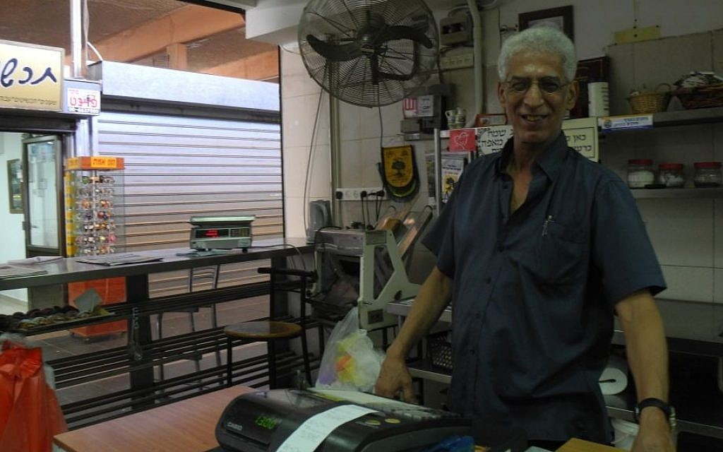 Sian Avner, owner of Sian's Bakery in Sderot, was one of the few shops open in the shuk in Sderot on Wednesday, August 27. Though the ceasefire held, residents were shaken and angry.  (photo credit: Melanie Lidman/Times of Israel)