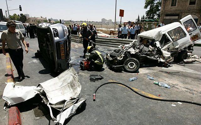 Cars lie strewn on Jaffa road after a terrorist in a tractor went on a rampage in central Jerusalem on JUly 2, 2008. (photo credit: Kobi Gideon/Flash90)