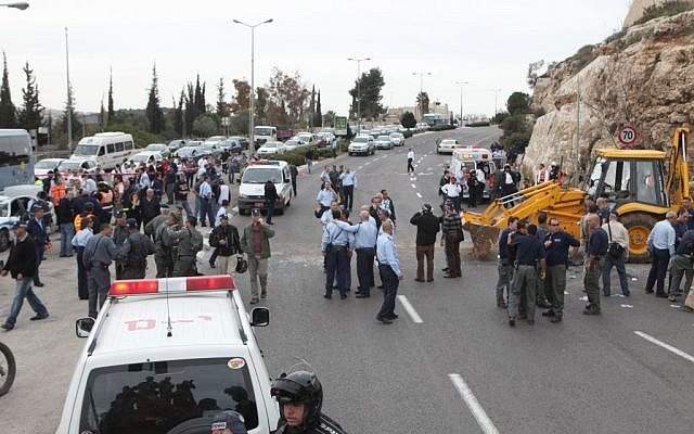 Israeli police officers and emergency personnel at the scene where a terrorist tractor driver slammed into vehicles in Jerusalem March 5, 2009. (Photo credit: Yossi Zamir/Flash90)