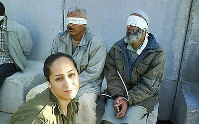 IDF soldier Eden Abergil, who photographed herself next to detained Palestinian prisoners, and published her photos on Facebook, 2010. (photo credit: Sachim.Tumbler.com/Flash90)