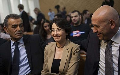 MK Hanin Zoabi (c) and Parliament member Jamal Zahalka (L) at the High Court of Justice courtroom for Zoabi's 2012 appeal against disqualification for upcoming elections due to her participation in the Turkish IHH flotilla (May 2010) aboard the Mavi Marmara. (photo credit: Yonatan Sindel/Flash90 )