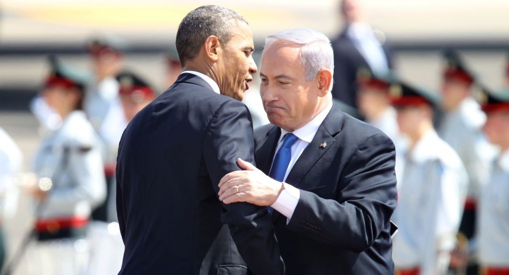 Prime Minister Benjamin Netanyahu, right, and President Barack Obama embrace at a ceremony welcoming the US leader at Ben Gurion Airport near Tel Aviv, on March 20, 2013 (photo credit: Miriam Alster/Flash90)