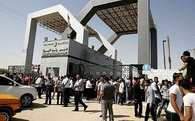 Illustrative photo of Palestinians waiting at the Rafah border crossing between Egypt and the southern Gaza Strip on June 17, 2014 (photo credit: Abed Rahim Khatib/Flash90)