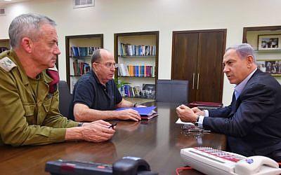 Prime Minister Benjamin Netanyahu (R), Defense Minister Moshe Ya'alon (C), and IDF Chief of Staff Benny Gantz seen during a meeting at Hakirya Base in Tel Aviv, July 26, 2014 (photo credit: Ariel Hermoni/Flash90)