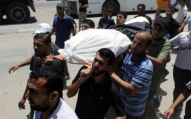 Palestinian relatives and friends carry the body of Hazem Abu Shamalah, 25, during his funeral in Khan Yunis, the southern Gaza Strip, July 27, 2014 (photo credit: Abed Rahim Khatib/Flash90)