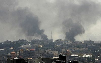 Smoke rises following what witnesses said were Israeli air strikes in Rafah, in the southern Gaza Strip, Friday, August 1, 2014. (photo credit: Abed Rahim Khatib/Flash90)