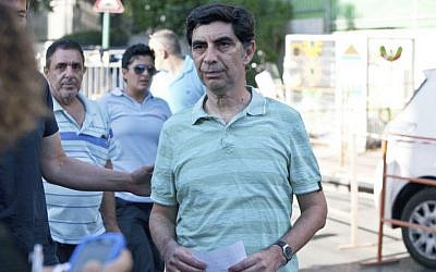Simha Goldin, father of Second Lieutenant Hadar Goldin, speaks with the media outside the Goldin family home in Kfar Saba on Friday, August 1, 2014, after his son was reported kidnapped (Flash90)