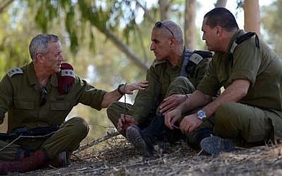 IDF Chief of Staff Benny Gantz (left) and Southern Command Chief Sami Turgeman (center), seen during a visit to the Givati Brigade near the Israeli border with Gaza, August 2, 2014. (Photo credit: Judah Ari Gross/IDF SPokesperson/FLASH90)