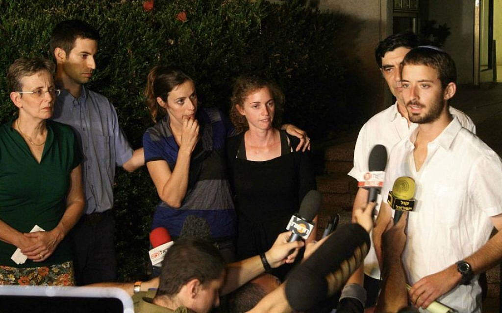 Zur Goldin (R), brother of Israeli soldier Hadar Goldin, and other family members talk to the media outside their home in the central Israeli city of Kfar Saba on August 2, 2014. (Photo by Flash90)
