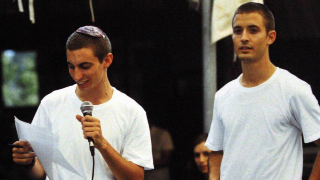 A photo showing Hadar Goldin (L), killed in Gaza on Friday, August 1, 2014, and his brother Zur Goldin (R). (photo by Flash90)