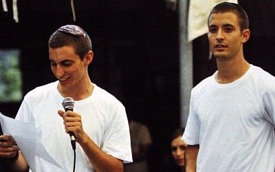 Hadar Goldin (left), and his twin brother Tzur. The IDF spokesman early August 3 announced the death of of IDF officer Lt. Hadar Goldin, who fell in battle in the Gaza Strip on August 1. (Photo credit: Flash90)