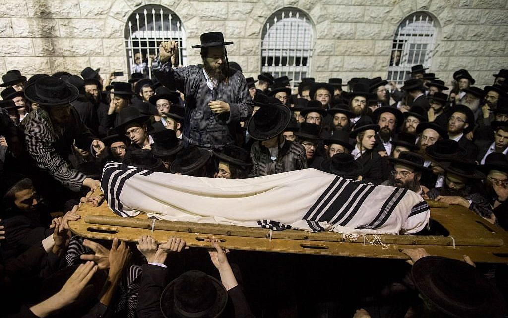 The August 5 funeral for Avraham Waltz, killed in a terror attack in Jerusalem on August 4, in the capital's Mea Shearim neighborhood. (photo credit: Yonatan Sindel/Flash90)