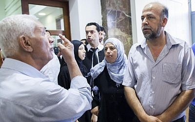 File: The family of Muhammed Abu Khdeir is seen outside the Jerusalem District after a court hearing against the 16-year-old youth's suspected killer. (photo credit: Yonatan Sindel/Flash90)
