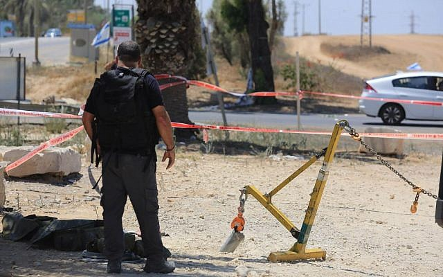 Police sappers inspect a part of a rocket that exploded inside Israel near the border with the Gaza Strip on August 8, 2014.  (photo credit: Edi Israel/Flash90)