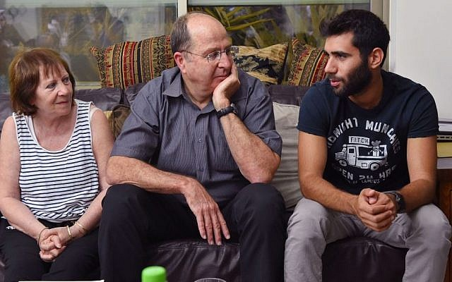 Then-defense minister Moshe Ya'alon visits the family of IDF Golani Brigade soldier St.-Sgt. Oron Shaul in the northern village of Poria on August 10, 2014 (Photo credit: Ariel Hermoni/Ministry of Defense/Flash90)