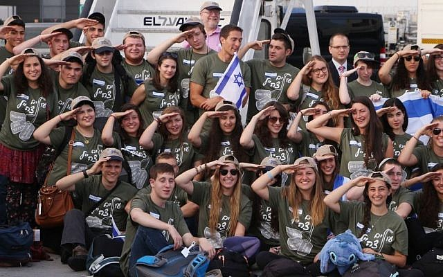 Some of the more than 100 men and women who immigrated to Israel to join the IDF, Ben Gurion airport, August 12, 2014. (photo credit: Flash90)