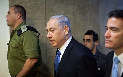 Israeli Prime Minister Benjamin Netanyahu arriving at the weekly cabinet meeting in Jerusalem, August 17, 2014. (photo credit: Emil Salman/Flash90/Pool)