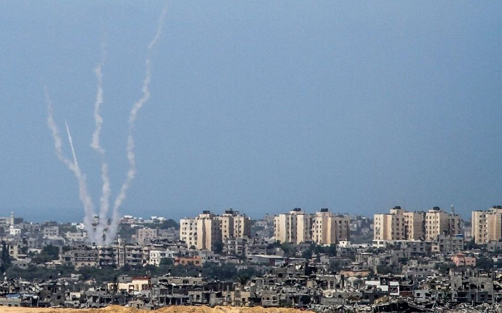 Illustrative: The Israel-Gaza border, from the Israeli side, with rockets being fired by Palestinian terrorists from the Gaza Strip into Israel, August 20, 2014. (Albert Sadikov/Flash90)