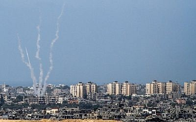 A picture taken from the Israeli side of the Israel-Gaza Border on August 20, 2014, shows rockets being fired by Palestinian terrorists from the Gaza strip into Israel. (photo credit: Albert Sadikov/Flash90)
