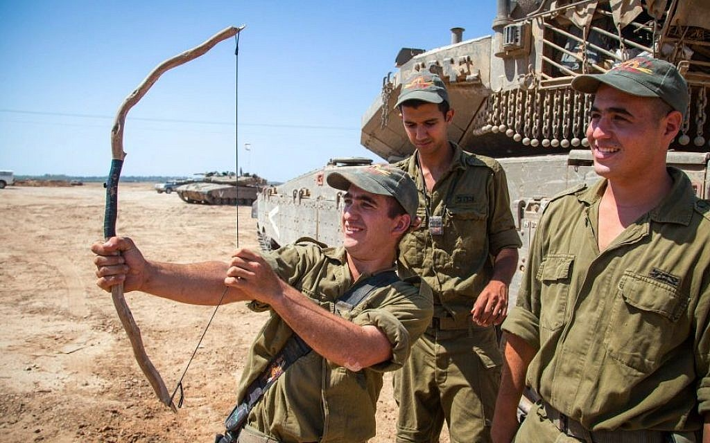 Israeli soldiers seen at a deployment area near the border with the Gaza Strip on August 20, 2014, (photo credit: Albert Sadikov/Flash90)