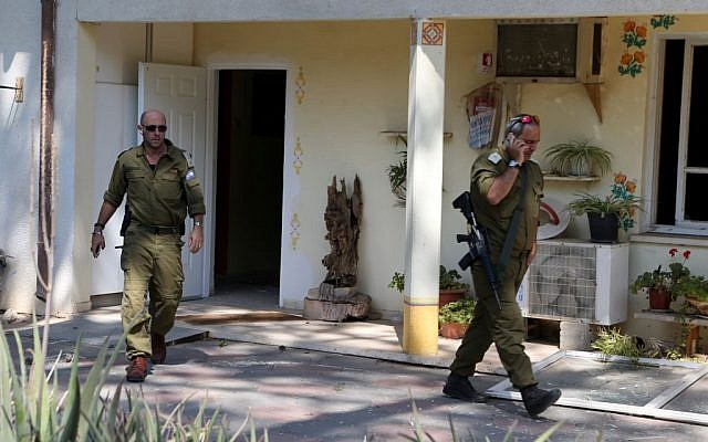 soldiers seen at a kindergarten that was directly hit by a mortar fired from Gaza, in the Eshkol region of southern Israel, August 21, 2014. Jan Berman, a 33-year-old man, was injured from the explosion. (Photo credit: Flash90)