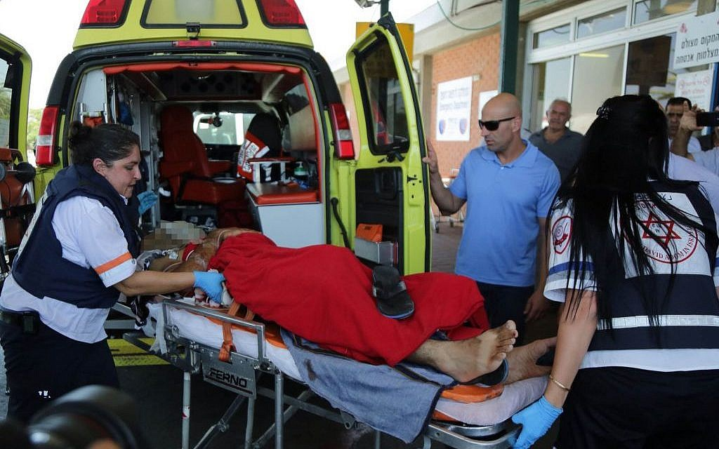 A man injured by a mortar shell is rushed to the emergency room after arriving at Barzilai Hospital in Ashkelon on August 24, 2014. (photo credit: Edi Israel/Flash90)