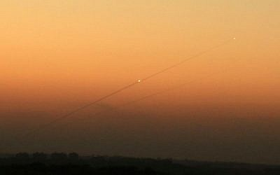 Illustrative: A trail of smoke from a rocket as it was launched from the Gaza Strip toward the southern Israeli city of Ashkelon, August 24, 2014. (Edi Israel/Flash90/File)