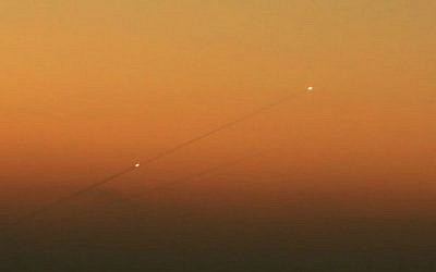 Illustrative. A trail of smoke is seen as rockets launched from the Gaza Strip streak towards the southern Israeli city of Ashkelon on August 24, 2014. (Edi Israel /Flash90/File)