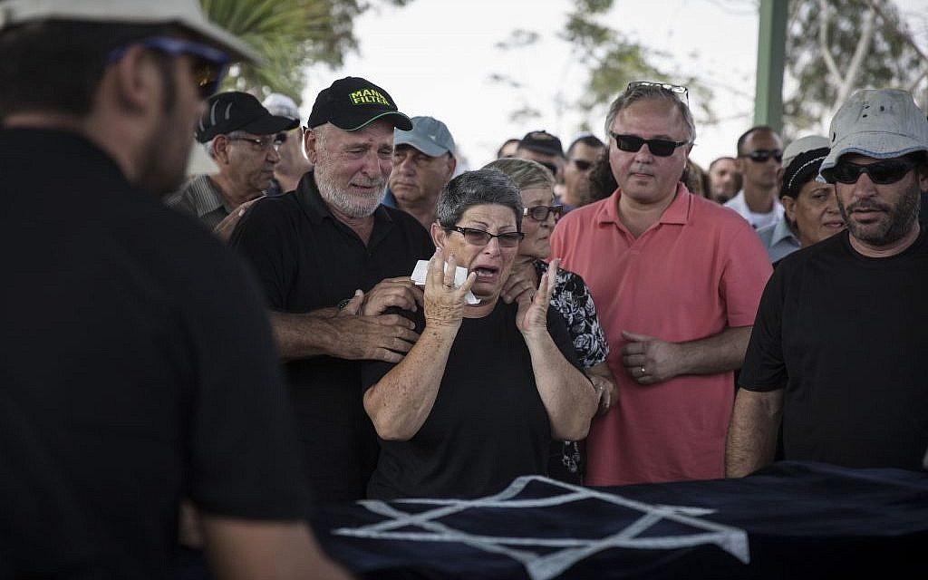 The grandmother of 4-year-old Daniel Tragerman mourns during his funeral at the Hevel Shalom Cemetery in Southern Israel, August 24, 2014 (photo credit: Hadas Parush/Flash90)