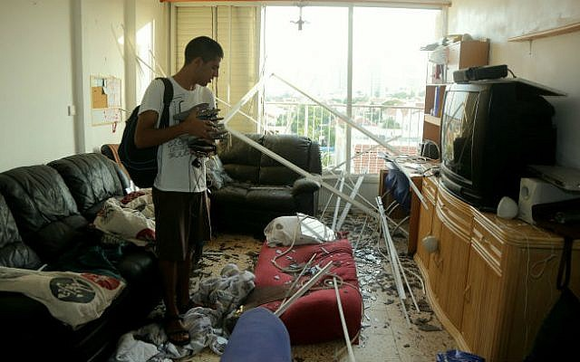 An apartment building that was damaged by the explosion from a rocket, fired in the Gaza Strip, which hit a neighboring house in Ashkelon, southern Israel, early morning on August 26, 2014.  (photo credit: Edi Israel/Flash90)