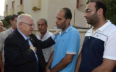 President Reuven Rivlin visits the family of the late Yussuf Haj Yahya, in the Israeli-Arab city of Taybe, on August 28, 2014. Haj, a principal at the Amal school in Taybe, was murdered on August 24 at his school. (Photo credit: Mark Neyman/GPO/Flash90)