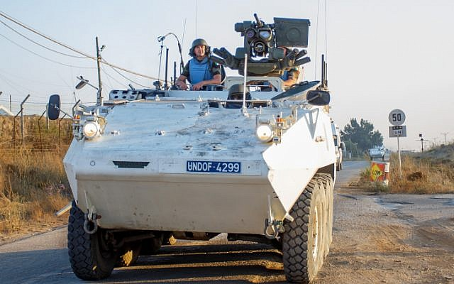 A UN peacekeeper on an armored personnel carrier (APC) along the Israel-Syrian border on August 30, 2014 (photo credit: Flash90)