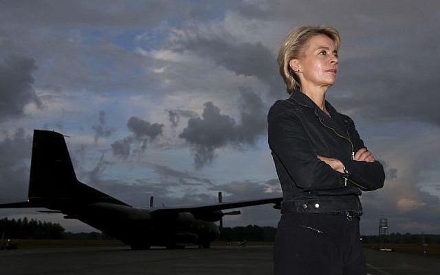 German Defense Minister Ursula von der Leyen stands in front of a Transall transport aircraft of German Bundeswehr at the airfield Hohn in Alt Duvenstedt, Germany, Friday, August 15, 2014. (AP Photo/Axel Heimken, pool)