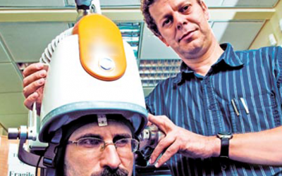 Prof. Abraham Zangen (right) poses with his machine (photo credit: courtesy)
