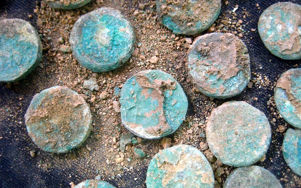 A selection of Jewish Revolt coins found at a Roman-era site outside Jerusalem in 2014. (photo credit: Ilan Ben Zion/Times of Israel staff)