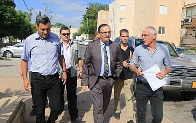 Education Minister Shai Piron (center) with mayors of towns in southern Israel on a tour of school readiness due to the current security situation, on Monday, August 25, 2014. (photo credit: Courtesy Education Ministry)
