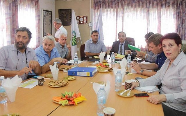 Education Minister Shai Piron with the heads of regional councils in southern Israel at a meeting in Beer Sheva on Monday to talk about the security situation.  (COURTESY: Education Ministry)