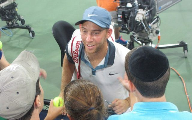 Israeli tennis player Dudi Sela greets Jewish fans after his victorious US Open match August 28, 2014. (Howard Blas/The Times of Israel)
