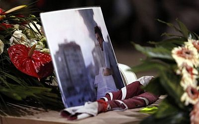 A picture of Associated Press video journalist Simone Camilli lies on his coffin during the funeral service at the Pitigliano Cathedral, Italy, Friday, Aug. 15, 2014. (AP Photo/Riccardo De Luca, Pool)