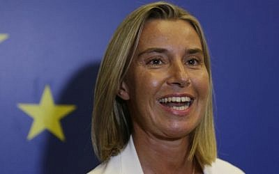 Italy Foreign Minister Federica Mogherini smiles as she meets the media during an informal meeting of the EU Foreign Affairs Ministers, in Milan, Italy, Friday, Aug. 29, 2014. (Photo credit: AP/Luca Bruno)