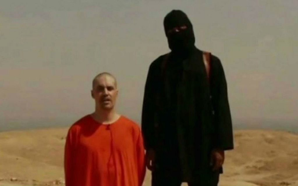 American journalist James Foley, kneeling in orange, in a video released by the Islamic State, which apparently showed him being beheaded by his captor, August 19, 2014. (screen capture: YouTube/News of the World)