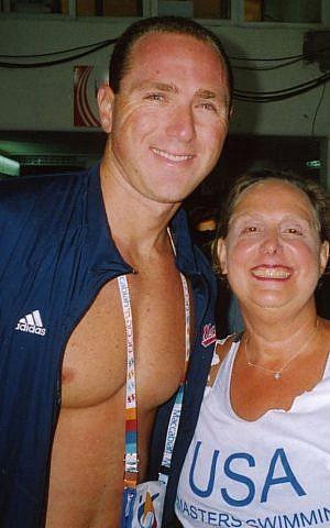 Jane Katz with Olympian Jason Lezak at the 18th Maccabiah Games. (Courtesy)