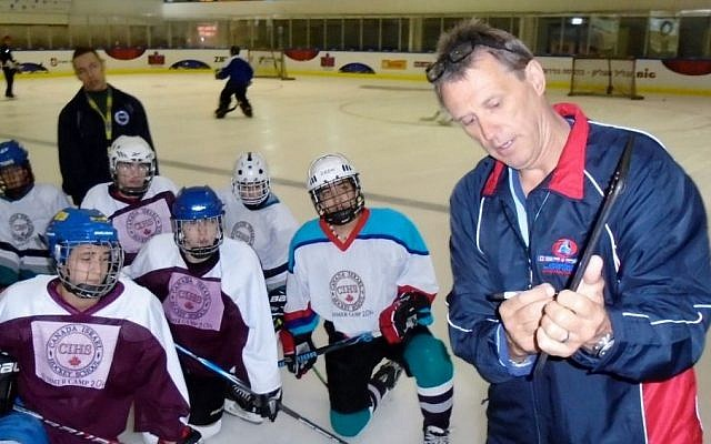 Ex-NHL player Laurie Boschman instructing young Israeli hockey players at the Canada Centre in Metulla, July 2014. (photo credit: JTA/Courtesy: Laurie Boschman)
